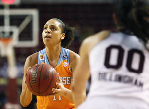 Photo - Tennessee forward Cierra Burdick (11) looks for a shot while Mississippi State guard Dominique Dillingham (00) closes in on her in the first half of an NCAA college basketball game in Starkville, Miss., Thursday, Jan. 16, 2014. (AP Photo/Rogelio V. Solis)