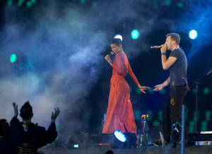 Photo -   Singer Rihanna performs with Chris Martin lead vocals of the British rock band Coldplay during the closing ceremony for the 2012 Paralympics games, Sunday, Sept. 9, 2012, in London. (AP Photo/Matt Dunham)