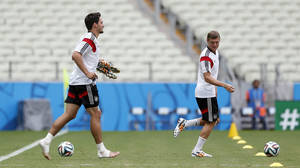 Photo - German national soccer players Mats Hummels, left, and Toni Kroos arrive for an official training session the day before the group G World Cup soccer match between Germany and Ghana at the Arena Castelao in Fortaleza, Brazil, Friday, June 20, 2014. (AP Photo/Matthias Schrader)