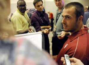 photo - Oklahoma quarterback Landry Jones, right, answers questions during Big 12 Media Days on Monday in Dallas. Jones says, among other things, that wife  Whitney Hand is 'a great cook.' AP PHOTO