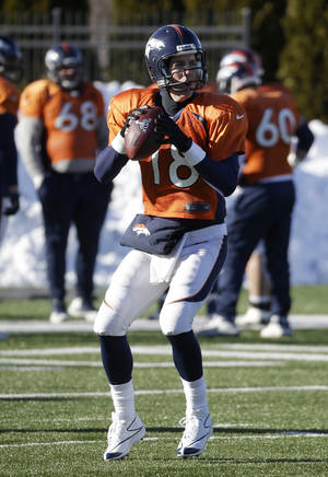 Photo - Denver Broncos quarterback Peyton Manning (18) passes during practice Wednesday, Jan. 29, 2014, in Florham Park, N.J. The Broncos are scheduled to play the Seattle Seahawks in the NFL Super Bowl XLVIII football game Sunday, Feb. 2, in East Rutherford, N.J. (AP Photo/Mark Humphrey)