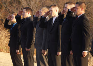 Photo - Six new cadets salute the flag during opening ceremonies for the Edmond Police Department's third basic police training academy.