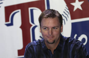 Photo - Texas Rangers catcher A.J. Pierzynski smiles as he arrives to sign autographs at the Rangers Fan Fest on Friday, Jan. 11, 2013, in Arlington, Texas. (AP Photo/LM Otero)