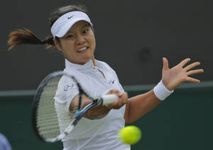 Photo - Li Na of China plays a return to Yvonne Meusburger of Austria during their women's singles match at the All England Lawn Tennis Championships in Wimbledon, London,  Wednesday, June 25, 2014. (AP Photo/Pavel Golovkin)