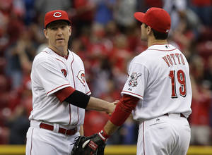 Photo - Cincinnati Reds' Joey Votto (19) congratulates Todd Frazier after they defeated the Chicago Cubs 5-2 in a baseball game on Saturday, May 25, 2013, in Cincinnati. Frazier had two RBIs in the game. (AP Photo/Al Behrman)