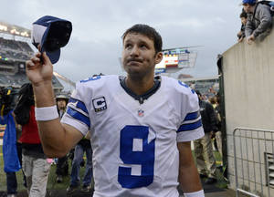 Photo - Dallas Cowboys quarterback Tony Romo leaves the field after the Cowboys defeated the Cincinnati Bengals 20-19 in an NFL football game, Sunday, Dec. 9, 2012, in Cincinnati. (AP Photo/Michael Keating)