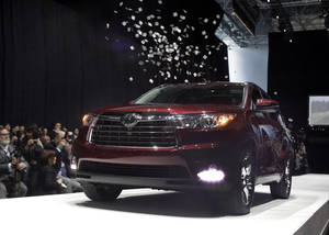 Photo - The 2014 Toyota Highlander is presented at the New York International Auto Show, in New York's Javits Center,  Wednesday, March 27, 2013. (AP Photo/Richard Drew)
