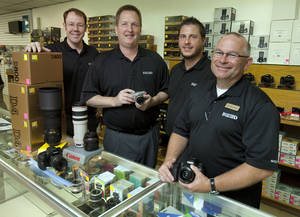 Photo - Store manager Eric Williams, Bedford Camera & Video vice presidents Steve Elkins and Jason Bedford and president Jeff Beauchamp at the new Oklahoma City location, formerly Epperson Photo-Video. <strong>STEVE SISNEY - THE OKLAHOMAN</strong>