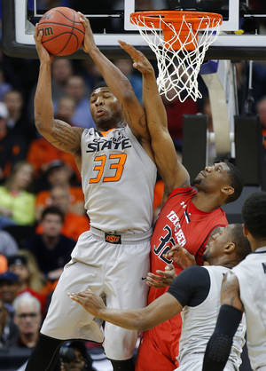 Photo - Oklahoma State's Marcus Smart (33) leaps for the ball beside Texas Tech's Jordan Tolbert (32) during the Big 12 tournament college basketball game between Oklahoma State University and Texas Tech at the Sprint Center in Kansas City, Mo., Wednesday, March 12, 2014. Oklahoma State won 80-62. Photo by Bryan Terry, The Oklahoman