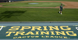 Photo - Oakland Athletics' Bartolo Colon walks back to the dugout after his physical Monday, Feb. 11, 2013, in Phoenix. The Athletics' pitchers and catchers start practice Tuesday. (AP Photo/Darron Cummings)