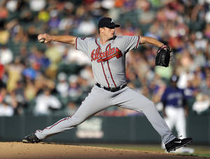 Photo - Atlanta Braves starting pitcher Gavin Floyd throws in the first inning of a baseball game against the Colorado Rockies on Monday, June 9, 2014, in Denver. (AP Photo/Chris Schneider)