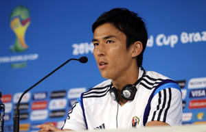 Photo - Japan's Makoto Hasebe speaks during a press conference at the Arena Pantanal in Cuiaba, Brazil, Monday, June 23, 2014.  Japan play in group C of the 2014 soccer World Cup. (AP Photo/Shuji Kajiyama)