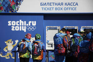 Photo - Workers line up outside a ticket box office on the Olympic Plaza ahead of the upcoming 2014 Winter Olympics, Thursday, Feb. 6, 2014, in Sochi, Russia. (AP Photo/David Goldman)