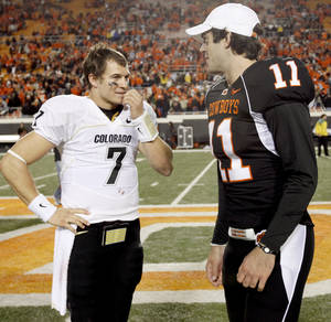 photo - OSU's Zac Robinson talks with Colorado's Cody Hawkins after the college football game between Oklahoma State University (OSU) and the University of Colorado (CU) at Boone Pickens Stadium in Stillwater, Okla., Thursday, Nov. 19, 2009. Photo by Bryan Terry, The Oklahoman