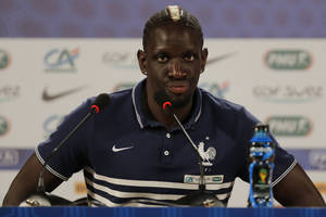 Photo - France's Mamadou Sakho attends a press conference at the Teatro Pedro II, in Ribeirao Preto, Brazil, Wednesday, July 2, 2014. France will face Germany in their World Cup quarterfinal, Friday. (AP Photo/David Vincent)