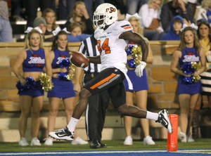 Photo - Oklahoma State's Hubert Anyiam (84) scores a touchdown during a college football game between the Oklahoma State University Cowboys and the University of Tulsa Golden Hurricane at H.A. Chapman Stadium in Tulsa, Okla., Sunday, Sept. 18, 2011. Photo by Sarah Phipps, The Oklahoman