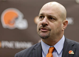 Photo - Cleveland Browns coach Mike Pettine speaks during a news conference Thursday, Jan. 23, 2014, in Berea, Ohio. Buffalo's defensive coordinator, who met with team officials for the first time just a week ago, finalized a contract Thursday to become the NFL football team's seventh full-time coach since 1999. (AP Photo/Tony Dejak)