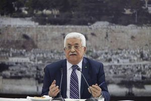 """Photo - Palestinian President Mahmoud Abbas talks during a leadership meeting in Ramallah, Tuesday, April 1, 2014. In a dramatic move that could derail eight months of U.S. peace efforts,  President Abbas resumed a Palestinian bid for further U.N. recognition despite a promise to suspend such efforts during nine months of negotiations with Israel. Abbas signed """"State of Palestine"""" applications for 15 U.N. agencies in a hastily convened ceremony after Israel calls off a promised prisoner release. (AP Photo/Majdi Mohammed)"""