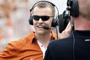 Photo - FILE - In this April 3, 2011, photo, Texas' new co-offensive coordinator Bryan Harsin gives an interview during the Texas Orange and White spring NCAA football scrimmage in Austin, Texas. (AP Photo/Michael Thomas, File) ORG XMIT: NY164