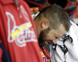 Photo -   St. Louis Cardinals' Chris Carpenter reacts in the dugout during the fourth inning of Game 6 of baseball's National League championship series against the San Francisco Giants Sunday, Oct. 21, 2012, in San Francisco. (AP Photo/David J. Phillip)