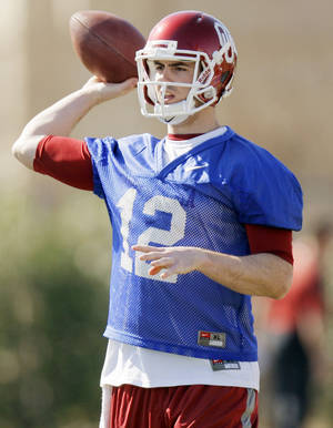 photo - COLLEGE FOOTBALL: Landry Jones (12) throws the ball during spring football practice for the OU Sooners on the campus of the University of Oklahoma in Norman, Okla., Monday, March 5, 2012. Photo by Nate Billings, The Oklahoman