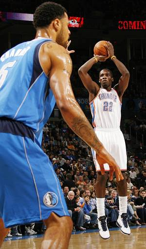 Photo - Oklahoma City's Jeff Green (22) shoots in front of Tyson Chandler (6) of Dallas during the NBA basketball game between the Dallas Mavericks and the Oklahoma City Thunder at the Oklahoma City Arena in Oklahoma City, Monday, Dec. 27, 2010. Photo by Nate Billings, The Oklahoman