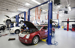 Photo - The ultra-modern service bay at the new Bob Moore Cadillac of Norman, on Interstate 35 at Indian Hills Road. Photos by STEVE SISNEY, The Oklahoman