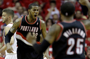 Photo - Portland Trail Blazers' LaMarcus Aldridge (12) reacts after making a basket while being fouled during the fourth quarter in Game 1 of an opening-round NBA basketball playoff series against the Houston Rockets  Sunday, April 20, 2014, in Houston. The Trail Blazers won 122-120 in overtime. (AP Photo/David J. Phillip)