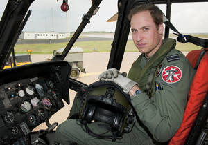 Photo - FILE - In this Friday, June 1, 2012  file photo released by Britain's Ministry of Defence , Britain's Prince William sits in the cockpit of a helicopter at RAF Valley in Anglesey Wales. Prince William has finished his tour of duty as a Royal Air Force search-and-rescue helicopter pilot and has left operational service with the British military to focus on royal duties and charity work, royal officials said Thursday, Sept 12, 2013.  William's Kensington Palace office said that the second in line to the British throne completed his final shift earlier this week.  (AP Photo/ SAC Faye Storer, MOD, File)