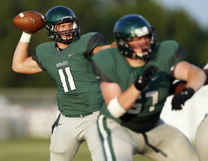Photo - HIGH SCHOOL FOOTBALL: Edmond Santa Fe's Justice Hansen (11) passes against Norman North during a football scrimmage at Edmond Santa Fe High School in Edmond, Okla., Thursday, Aug. 22, 2013. Photo by Nate Billings, The Oklahoman