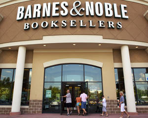 "photo -   FILE-In this Monday, June 18, 2012, file photo customers enter the Barnes and Noble Booksellers store in Hoover, Ala. Barnes & Noble says its fiscal first-quarter loss narrowed, lifted by sales of e-books and other digital content as well as sales of the ""Fifty Shades of Grey"" series at its bookstores. (AP Photo/Dave Martin)"