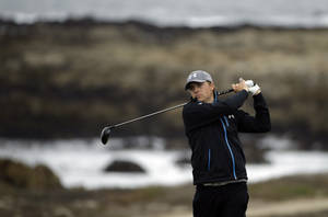 Photo - Jordan Spieth hits off the 13th tee Friday, Feb. 7, 2014, during the second round of the AT&T Pebble Beach Pro-Am golf tournament on the Monterey Peninsula Country Club Shore Course in Pebble Beach, Calif. (AP Photo/Ben Margot)
