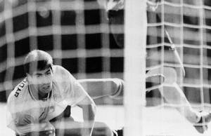 Photo - FILE - In this June 22, 1994 file photo, Colombia's Andres Escobar, lies on the ground and watches as a shot by America's Eric Wynalda misses the goal, during their World Cup soccer match, in the Rose Bowl, Pasadena, USA. The US defeated Colombia by 2-1. On this day: July 2, Escobar was shot dead in his home town of Medellin. The killing appeared to be directly linked to Escobar's own goal scored during Colombia's 2-1 defeat to the US. As a result, Colombia returned home early from a tournament many had expected it to do well in. (AP Photo/Eric Draper, File)