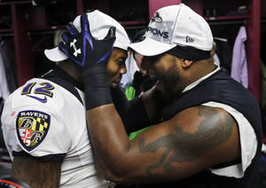 photo - Baltimore Ravens inside linebacker Ray Lewis, right, and Jacoby Jones (12) celebrate in the team's locker room after the NFL football AFC Championship game against the New England Patriots in Foxborough, Mass., Sunday, Jan. 20, 2013. The Ravens won 28-13 to advance to Super Bowl XLVII. (AP Photo/Elise Amendola)