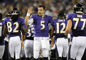 Photo -   Baltimore Ravens quarterback Joe Flacco (5) high-fives wide receiver Torrey Smith (82) after Anquan Boldin, not pictured, scored a touchdown in the first half of an NFL preseason football game against the Jacksonville Jaguars in Baltimore, Thursday, Aug. 23, 2012. Ravens wide receiver Jacoby Jones (12) and center Matt Birk (77) jog off the field at right. (AP Photo/Nick Wass)