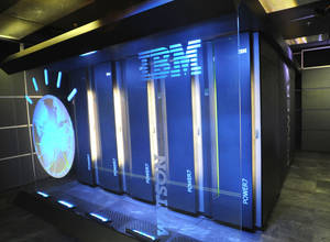 "Photo - FILE - A Jan. 13, 2011 file photo provided by IBM shows the IBM computer system known as Watson, at IBM's T.J. Watson research center in Yorktown Heights, N.Y. A partnership between IBM and seven of the country's top computer science universities, which was set to be announced Wednesday, May 7, 2014, will let students will use the ""Jeopardy!"" champion to develop new cognitive computing applications for a variety of industries ranging from health care to finance. (AP Photo/IBM, File)"