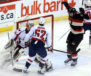 Photo - Ottawa Senators' Mika Zibanejad (93)celebrates his goal as Washington Capitals goaltender Philipp Grubauer (31) and Mike Green (52) look on during first period NHL hockey action in Ottawa, Ontario, on Monday, Dec. 30, 2013. (AP Photo/The Canadian Press, Fred Chartrand)