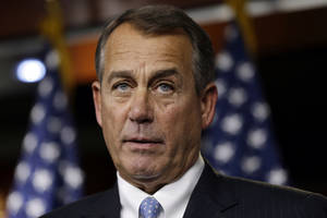 Photo - House Speaker Rep. John Boehner, R-Ohio, speaks to the media about the fiscal cliff at the U.S. Capitol in Washington, on Thursday, Dec. 20, 2012. (AP Photo/Jacquelyn Martin)