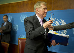"Photo - Retired Australian judge Michael Kirby, center, chairperson of the commission of Inquiry on Human Rights in the Democratic People's Republic of Korea, takes off his glasses after delivering the commission's report during a press conference at the United Nations in Geneva, Switzerland, Monday, Feb. 17, 2014. A U.N. panel has warned North Korean leader Kim Jong Un that he may be held accountable for orchestrating widespread crimes against civilians in the secretive Asian nation. Kirby told the leader in a letter accompanying a yearlong investigative report on North Korea that international prosecution is needed ""to render accountable all those, including possibly yourself, who may be responsible for crimes against humanity."" (AP Photo/Anja Niedringhaus)"
