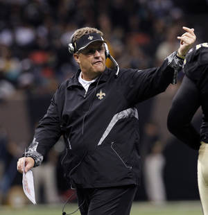 "Photo -   FILE - In this Dec. 12, 2010 file photo, New Orleans Saints defensive coordinator Gregg Williams gestures in the second half of an NFL football game aainst the St. Louis Rams, in New Orleans. A newly released recording purports to capture former Saints defensive coordinator Williams telling players to ""put a lick"" on San Francisco's Kyle Williams to see if the receiver has lingering effects from an earlier concussion. (AP Photo/Gerald Herbert, File)"