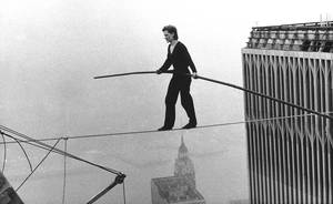 "Photo -   FILE - In this Aug. 7, 1974 file photo, Philippe Petit, a French high wire artist, walks across a tightrope suspended between the World Trade Center's Twin Towers in New York. Philippe Petit stars in ""Man on a Wire,"" directed by James Marsh. (AP Photo/Alan Welner, File)"