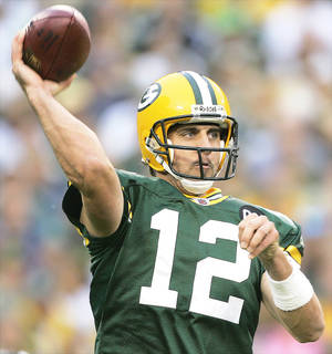 Photo - Packers quarterback Aaron Rodgers is trying to keep cool. AP photo