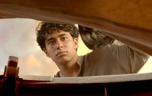 """Photo -   This film image released by 20th Century Fox shows Suraj Sharma as Pi Patel in a scene from """"Life of Pi."""" (AP Photo/20th Century Fox)"""