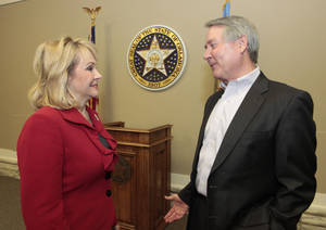 Photo - Gov. Mary Fallin and Secretary Robert Sommers talk before her cabinet meeting Dec. 11  at Capitol. Sommers is the secretary of education and workforce development. Photo by David McDaniel, The Oklahoman <strong>David McDaniel - The Oklahoman</strong>