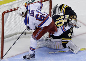 Photo - New York Rangers left wing Rick Nash (61) scores past Boston Bruins goalie Tuukka Rask (40) during a shootout of an NHL hockey game in Boston, Tuesday, Feb. 12, 2013. The Rangers won 4-3. (AP Photo/Elise Amendola)
