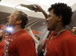 Photo - St. Louis Cardinals' Trevor Rosenthal has Champagne poured on him by teammate Carlos Martinez after Game 6 of the National League baseball championship series against the Los Angeles Dodgers Friday, Oct. 18, 2013, in St. Louis. The Cardinals won 9-0 to win the series. (AP Photo/Jeff Roberson)