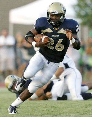 Photo - Heritage Hall's Barry Sanders takes the ball downfield against the Casady Cyclones during their high school football game at Heritage Hall in Oklahoma City on Thursday, September 1, 2011. Photo by John Clanton, The Oklahoman <strong>JOHN CLANTON</strong>