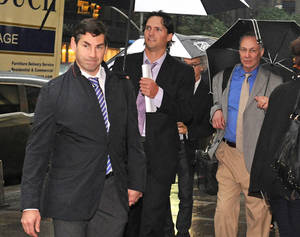 photo -   Matthew Schneider, left, special assistant to NHL Players Association executive director Donald Fehr, Winnipeg Jets' Ron Hainsey, center, and Steve Fehr, players union special counsel, arrive at NHL headquarters in New York, Friday, Sept. 28, 2012. With the clock ticking down to the start of the season, the NHL and its locked-out players are talking again. (AP Photo/ Louis Lanzano)