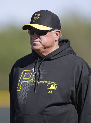 photo - Pittsburgh Pirates manager Clint Hurdle looks on during a baseball spring training workout on Sunday, Feb. 17, 2013, in Bradenton, Fla. (AP Photo/Charlie Neibergall)