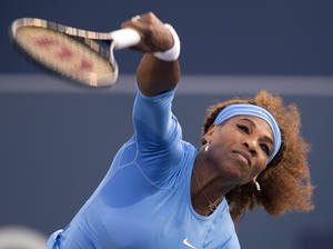 Photo - Serena Williams, of the United States, serves during her quarterfinal match against Magdalena Rybarikova, of Slovakia, at the Rogers Cup women's tennis tournament in Toronto, Friday, Aug. 9, 2013. (AP Photo/The Canadian Press, Frank Gunn)